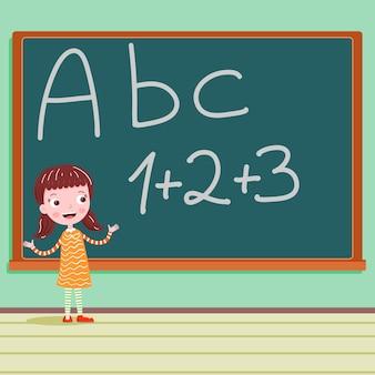 Uczeń na blackboard w sala lekcyjnej abc liście