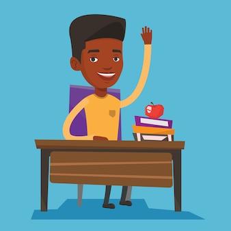 Uczeń podnosi rękę w klasie, aby uzyskać odpowiedź.