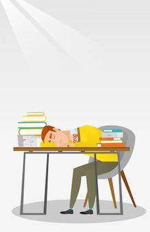 Uczeń śpi przy biurku z książką.