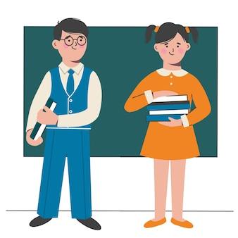 Uczniowie z podręcznikami w rękach stoją przy tablicy w klasie.