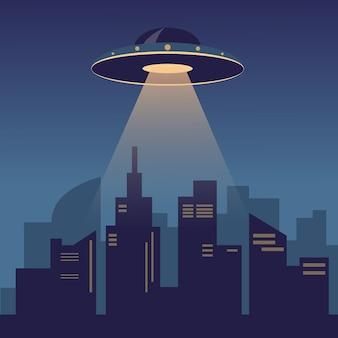 Ufo na ciemnym nocnym niebie nad nowoczesnym miastem