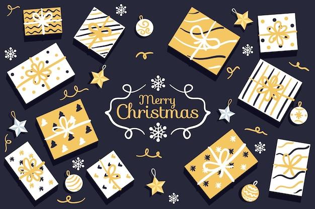 Układ złotych pudeł prezentowych w papierze pakowym