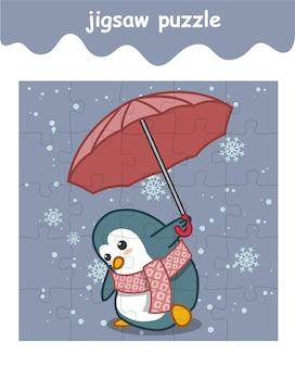 Układanka z pingwinem trzyma parasol