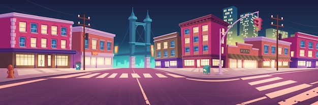 Ulica miasta z domami i wiadukt drogi w nocy