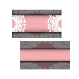 Ulotka różowa z indyjskimi białymi ornamentami do swojego projektu.