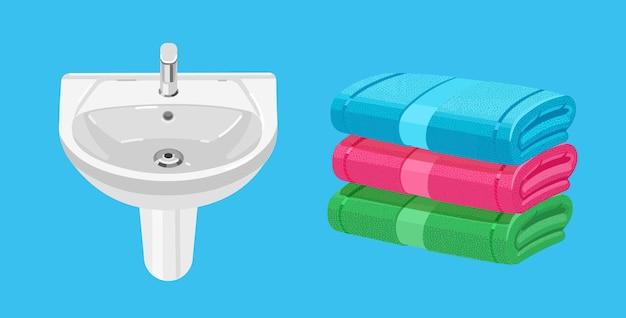 Umywalka łazienkowa z baterią biała umywalka domowa. ręcznik kąpielowy