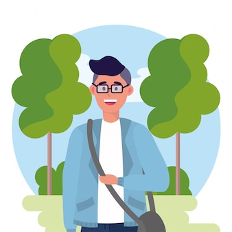 Uniwersytecki mężczyzna z szkłami i drzewami z krzakami