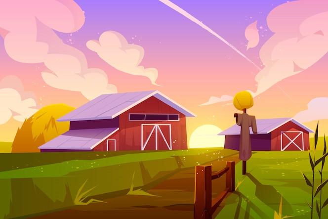 Uprawia ziemię na lato natury wiejskim tle z stajnią