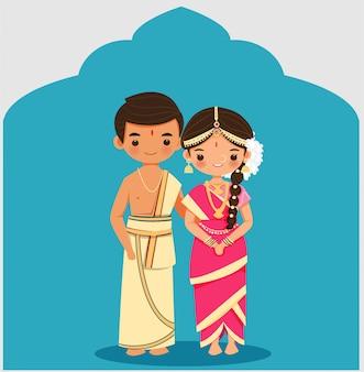 Urocza indyjska para w sukni ślubnej z tradycji tamil iyengar