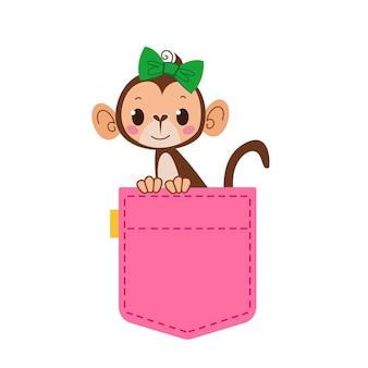 Urocza kieszeń różowych dżinsów, z której podgląda małpka z kokardą na głowie