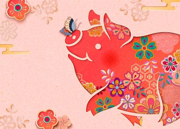 Urocza kwiecista świnka na jasnoróżowym tle z motylem i kwiatami