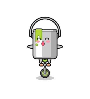 Urocza postać z puszki z farbą jedzie na rowerze cyrkowym, ładny styl na koszulkę, naklejkę, element logo