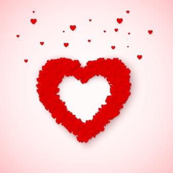 Urocza ramka w kształcie serca z konfetti w małe czerwone i różowe serduszka. poczucie miłości w św. walentynki