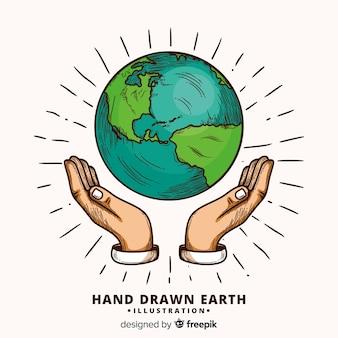 Urocza ręka rysująca planety ziemi skład