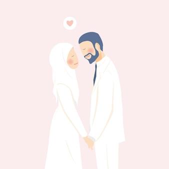 Urocza romantyczna muzułmańska para ślubna trzymająca się za ręce zadowolona i szczęśliwa w chwili ślubu
