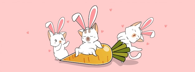 Urocze koty i duża marchewka w wiosenny dzień