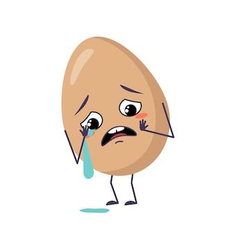 Urocze postacie jajek z emocjami płaczu i łez stoją przed ramionami i nogami