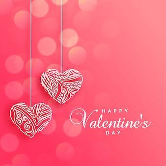 Uroczy dekoracyjni serca na różowym bokeh tle
