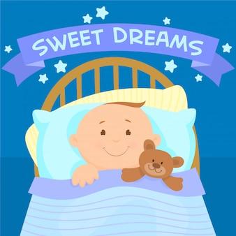 Uroczy mały chłopiec leży w łóżku z misiem
