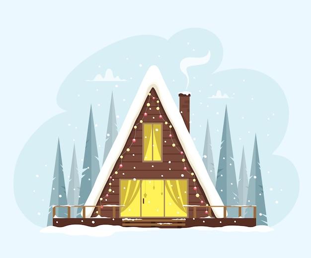 Uroczy trójkątny domek wśród lasu ozdobiony światłami. świąteczna i przytulna atmosfera. ilustracja w stylu płaski. wesołych świąt.