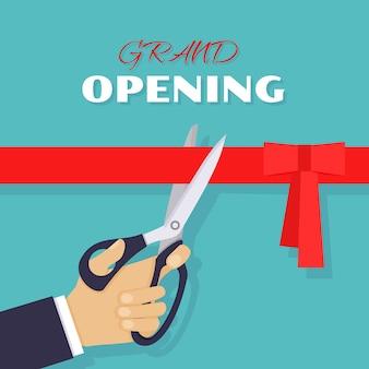 Uroczyste otwarcie, uroczystość i wydarzenie. nożyczki przecinają czerwoną wstążkę.