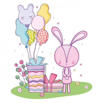 Urodzinowy śliczny szczęśliwy królik z teraźniejszość prezentami i balonami