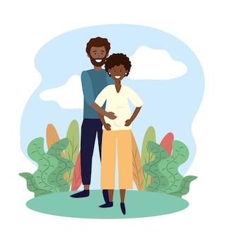 Uśmiech kobiety i mężczyzny para w ciąży z roślinami