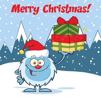 Uśmiechający się mały yeti kreskówka maskotka z santa hat trzyma prezenty.