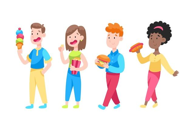 Uśmiechnięci ludzie z niezdrowym jedzeniem