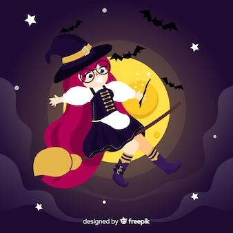 Uśmiechnięta halloween czarownica lata w zmroku