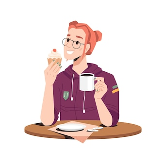 Uśmiechnięta kobieta cieszy się ciastem piekarniczym z kawą herbacianą lub kakao na białym tle dziewczyna w okularach przy stole