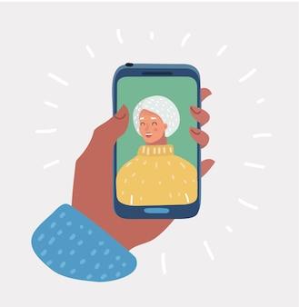 Uśmiechnięta stara kobieta na wyświetlaczu smartfona