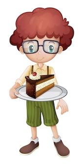 Uśmiechnięty dzieciak trzyma plasterek tort