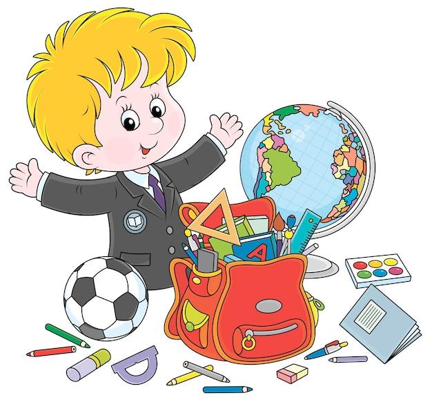Uśmiechnięty mały uczeń z zasadami podręczniki zeszyty ćwiczeń ołówki długopisy piłka nożna kula ziemska i tornister wektor ilustracja kreskówka na białym tle