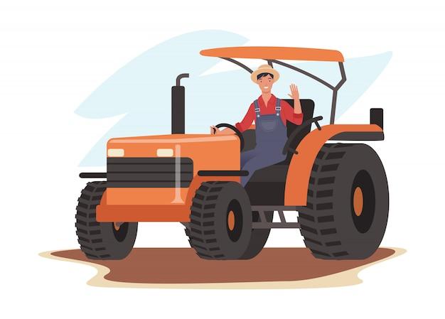 Uśmiechnięty rolnik jedzie ciągnikiem i macha cześć.