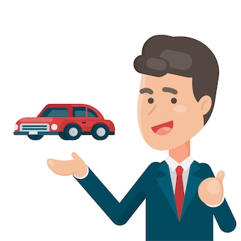 Uśmiechnięty sprzedawca pokazuje samochód