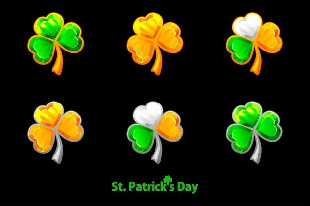 Ustaw cenną koniczynę na dzień świętego patryka na czarnym tle. biżuteria koniczyna, symbole koniczyny złote, zielone.