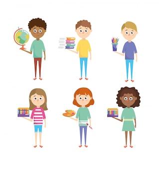 Ustaw dzieci chłopców i dziewczęta przy pomocy przyborów szkolnych