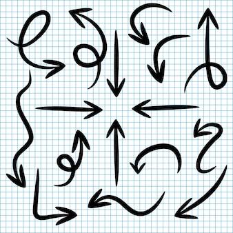 Ustaw strzałki doodle na papierze