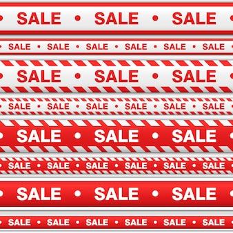 Ustawić taśmy bez szwu ze sprzedażą napisów. wstążki w kolorze czerwonym i białym do wskazania miejsca sprzedaży na białym tle.