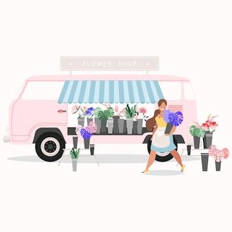 Van kwiaciarni. koncepcja kwiaciarni. różowa furgonetka sprzedająca kwiaty. uśmiechnięta żeńska kwiaciarni mienia roślina. rośliny, kwiaty, liście palmowe w wiadrach. rynek kwiatowy. ciężarówka różowy kwiat. nowoczesny.