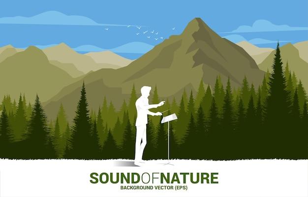 Vector dyrygent orkiestry muzycznej z zielonym lasem i dużą górą. koncepcja tło dla muzyki na czas naturalny i wiosenny.