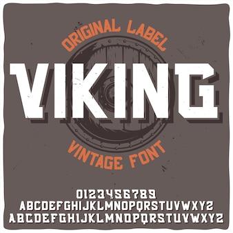 """Vintage etykieta o nazwie """"viking"""" z ilustracją tarczy."""