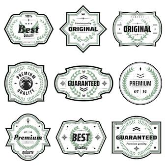 Vintage kolorowe emblematy premium zestaw o różnych kształtach z napisami i kwiatowymi zielonymi wieńcami na białym tle