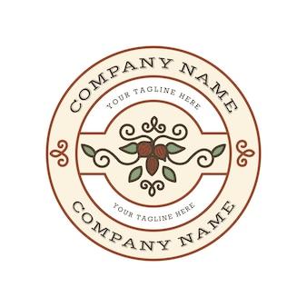 Vintage logo szablon z orzechami i liśćmi w emblemacie koła z białym tłem