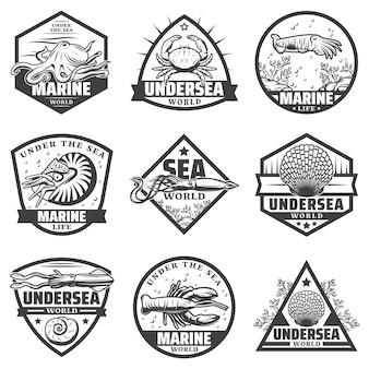 Vintage monochromatyczne etykiety zwierząt morskich zestaw z ośmiornicą krewetki mątwy homar krab kalmary na białym tle