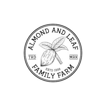 Vintage retro rustykalne logo orzechów migdałowych ręcznie rysowane stylu dla firmy rolnej
