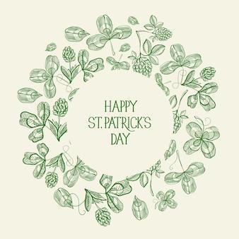 Vintage st patricks day zielona kartka z życzeniami z napisem w okrągłej ramie i szkic ilustracji wektorowych irlandzkiej koniczyny