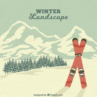 Vintage zimowy krajobraz z nartami