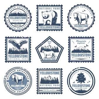 Vintage znaczki parku narodowego z napisami przedstawiają orła bawole puma i krajobrazy przyrody na białym tle